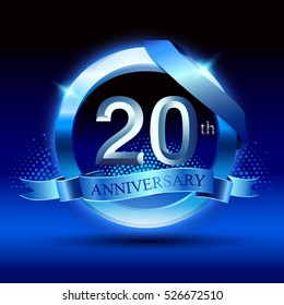 Celebrating 20th anniversary logo, with silver ring and blue ribbon isolated on black  background.