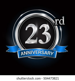 Celebrating 23rd anniversary logo. with silver ring and blue ribbon.