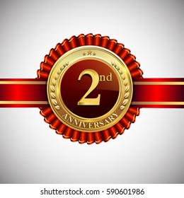 Celebrating 2nd anniversary logo, with golden badge and red ribbon isolated on white background.