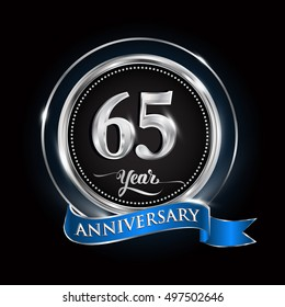 Celebrating 65 years anniversary logo. with silver ring and blue ribbon.