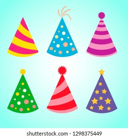 Celebration set of colorful birthday party hats on blue bacground