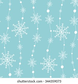 Celebratory pattern with snowflakes hanging on strings.