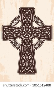 Celtic cross with national ornament as interlaced ribbon. Old brown background with the aging effect.
