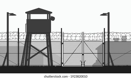 chain fence and guard tower at military base