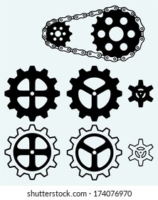 Chain gears and set cogs isolated on blue background