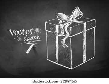 Chalkboard drawing of gift box. Vector illustration. Isolated.
