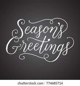 Chalkboard Season's Greetings Hand-lettered holiday message isolated on a dark grey chalkboard style background
