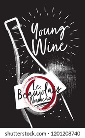 Chalked Bottle of wine close up. Etiquette and logo for the festival of young wine. Black charcoal background