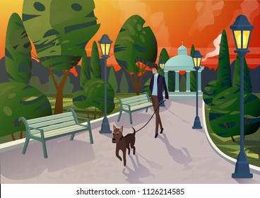 Character of elegant man with dog on leash strolling on walkway in city park in sunset light.