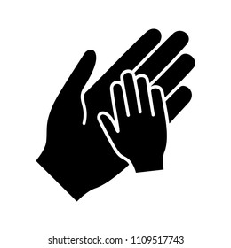 Charity for children glyph icon. Silhouette symbol. Parent and child hands together. Child protection. Parenthood. Family. Negative space. Vector isolated illustration