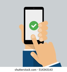 Check mark on smart-phone screen. Hand holding smart phone. Finger on mobile device screen. Creative modern flat design.