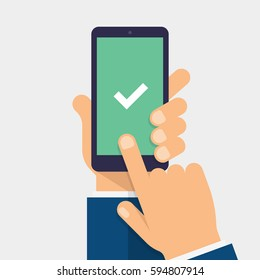 Check mark on smart-phone screen. Hand holding smart phone. Finger on mobile device screen. Modern flat vector illustration.