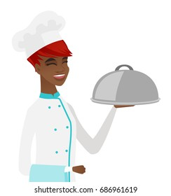 Cheerful african-american chef in uniform holding restaurant cloche and towel. Young happy smiling chef with cloche and towel. Vector flat design illustration isolated on white background.