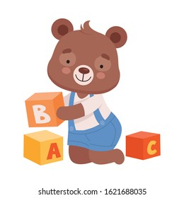 Cheerful Bear Character Wearing Playsuit Sitting on the Floor and Playing Alphabet Cubes Vector Illustration