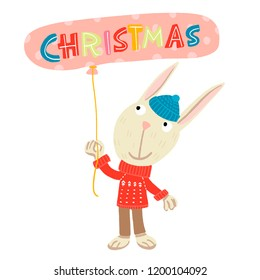 cheerful hare in a blue hat and a red sweater with a white pattern, standing with a ball of pink polka dots in his hands with the inscription-Christmas
