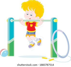 Cheerful little boy pulling himself up on a sport horizontal bar in a gym, vector cartoon illustration isolated on a white background