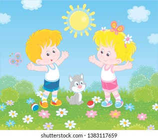 Cheerful little kids doing morning exercises among flowers on green grass of a lawn on a sunny day, vector illustration in a cartoon style