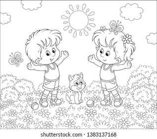 Cheerful little kids doing morning exercises among flowers on a lawn on a sunny day, black and white vector illustration in a cartoon style for a coloring book