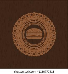 cheeseburger icon inside wood emblem. Retro