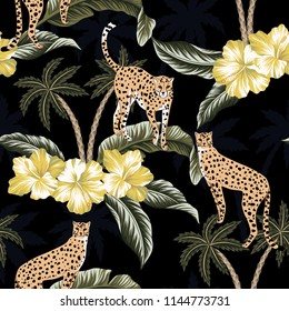 Cheetah, yellow hibiscus flowers and  tropical palm trees floral black background seamless pattern. Exotic wallpaper.