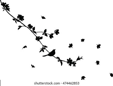 cherry tree branch with flying flowers and a blackbird