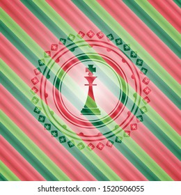 chess king icon inside christmas style badge..