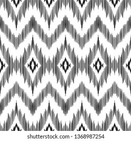 Chevron seamless pattern in aztec style. Black and white textured print for textile, wallpaper, card or wrapping paper.