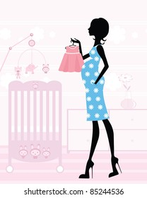 Chic pregnant mom-to-be in her upcoming baby`s nursery