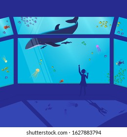 Child girl in the aquarium shows on a floating whale. Behind glass in water multi-colored fishes and jellyfish swim. Vector in blue colors.