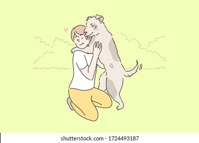 Child playing with dog concept. Young boy child kid owner cartoon character hugging embracing with happy pet puppy licking face in park outside. Summer leisure time animal love or devoted friendship.