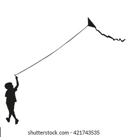 child silhouette flying a kite