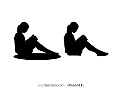child sitting reading silhouette