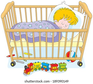 Child sleeps in a bed in a kids bedroom with toys