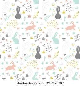 Childish seamless pattern with bunny, hand drawn shapes ,forest and floral elements. Great for fabric, textile, wrapping paper. Scandinavian style.