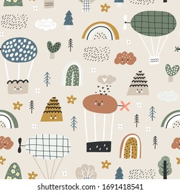 Childish seamless pattern with cute balloons, clouds, hills and trees for baby apparel, cloth texture, textile or decoration. Pastel colors.