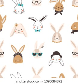 Childish seamless pattern with funny bunny faces on white background. Backdrop with cute rabbits or hares wearing glasses, sunglasses, hat, scarf, headscarf, bow tie. Flat cartoon vector illustration.