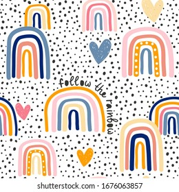 Childish seamless pattern with hand drawn rainbow, hearts and dots. Trendy kids vector background.