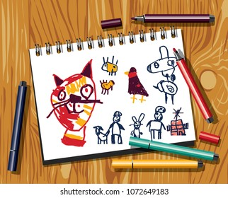 Children doodles draw cat felt pen paper and wood background.
