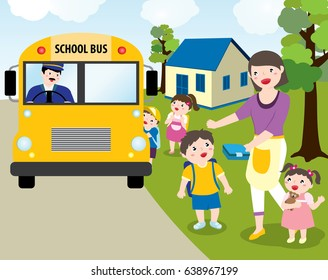 Children Going To School With School Bus. Mom Handing Over His Son's Lunch Box