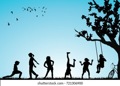 Children silhouettes playing in a park