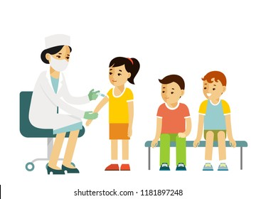 Children vaccination concept. Doctor pediatrician makes an injection of flu vaccine to a kid in hospital.  Healthcare, medical treatment, prevention and immunize.