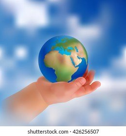child's hand holding a globe. Peace in the hands of a child. Hand on a background of sky and clouds. Realistic objects.