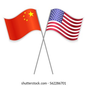 Chinese and American crossed flags. China combined with United States of America isolated on white. Language learning, international business or travel concept.