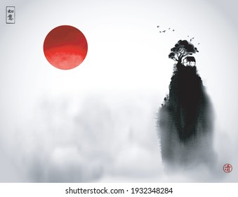 Chinese landscape with little house under the big tree on high hill and big red sun. Traditional oriental ink painting sumi-e, u-sin, go-hua. Hieroglyphs - dreams come true, zen
