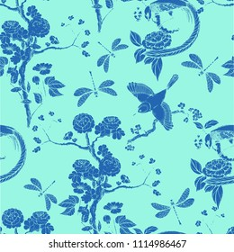 Chinoiserie seamless pattern. Vector illustration with silhouette. Chinese background.  Birds, peonies, dragonfly. Wallpaper design. Blue background.
