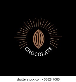 Chocolate logo, emblem, badge or label with cocoa bean. Vintage retro style. Isolated on black background. Vector illustration.
