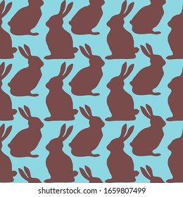 Chocolate rabbits and Easter eggs on blue background. Seamless pattern. Texture for fabric, wrapping, wallpaper. Decorative print. Vector illustration .