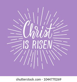 Christ is risen! Modern calligraphy with rays of light frame around.