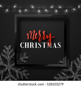 Christmas background black color with realistic garlands and beautiful snowflakes in the frame. Template christmas greeting card. Xmas Holiday and Happy New Year