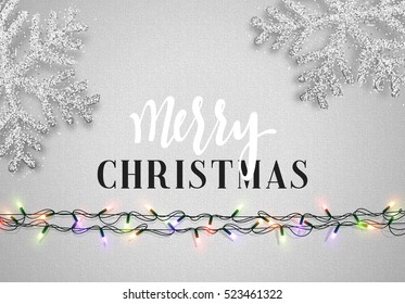 Christmas background gray color with realistic garlands and beautiful snowflakes. Template christmas greeting card. Xmas Holiday and Happy New Year
